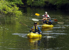 Birding. Karenna Snow, left, Tina Hay and Cliff Jones of the Rancocas Conservancy Brown Creekers look for birds while kayaking in Mount Holly Saturday during the stock photos