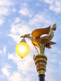Birdlamp. Golden bird statue on the top of pole with blue sky Royalty Free Stock Photography