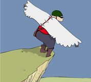 Bird man. Man with wings about to jump from cliff Royalty Free Stock Image