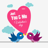 2 birds with big heart and message written on it. 2 birds loving each other with Valentine message on big heart royalty free illustration
