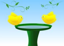 Birds on birdbath Royalty Free Stock Images