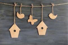 Birds, birdhouses, butterflies on a rope
