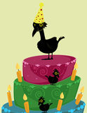 Birds with birthday cake. Large and small black birds on a brightly colored three tier birthday cake with candles royalty free illustration