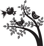 Birds black and white graphics. Two birds sitting on a tree, one flies, black and white graphics Stock Photo