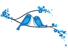 Birds on the branch. Pair of blue birds sitting on the blooming branch. Created in Illustrator Royalty Free Stock Image