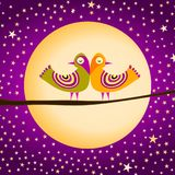 Birds couple with full moon and stars. A couple of birds on a branch with full moon on the background and a starry purple night Royalty Free Stock Images