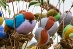 Birds decorative. Decorative birds in different colors on the stick Royalty Free Stock Photo