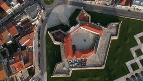 Birds eye aerial view of old Napoleonic star fort in Povoa de Varzim, Portugal. Fortaleza de Nossa Senhora da Conceicao, moving slowly up / pulling back stock video