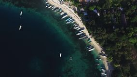 Aerial drone view of boats anchored in the bay with clear and turquoise water. Birds Eye shot, Overhead Shot, Helicopter or aerial drone view of boats anchored stock video footage