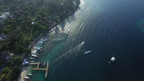Aerial drone view of boats anchored in the bay with clear and turquoise water. stock footage