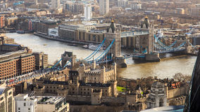 Birds eye veiw on Tower Bridge and River Thames in London. London city center with most know famous town attraction lifting Tower Bridge over river Thames. Tower Stock Photo