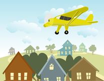 Birds Eye View. Illustration of a single engine plane flying over a town Stock Photo