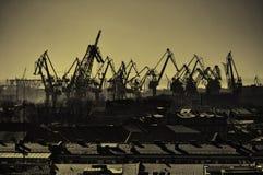Birds eye view of cargo crane in port of Saint-Petersburg, Russia - urban landscape in sepia tones Stock Photos