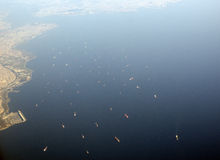 Birds eye view of cargo ships cruising near land Royalty Free Stock Images