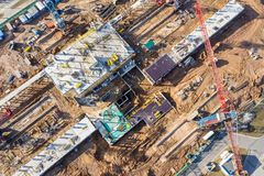 Birds eye view on construction site with tower cranes and building royalty free stock photo