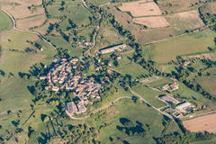 Birds eye view of cultivated land, roads and private houses Royalty Free Stock Images