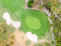 Birds eye view of golf course hole green and sand traps. royalty free stock photos