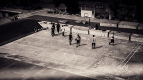 Birds Eye View and Grayscale Photo of People Playing Basketball Stock Photo