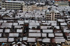 Birds eye view of house roofs with snow Shanghai China. Shanghai, China - February 19, 2013: A birds eye view of an older communist era neighborhood of Shanghai Royalty Free Stock Photo