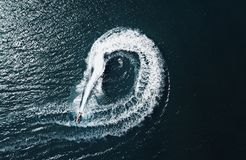 Jetski circles. Birds eye view of a jet ski going in an abstract circular pattern taken from a drone royalty free stock photos