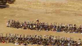 Group of bikes parked with people. A birds eye view shot of people and their bikes parked in slow motion. Camera slowly zooms out stock footage