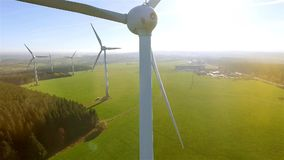 Birds eye view on Wind Power Turbine. AERIAL 4K / Ultra HD - Birds eye view on Wind Power, Turbine, Windmill, Energy Production - Clean and Renewable Energy stock video