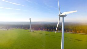 Birds eye view on Wind Power Turbine. AERIAL 4K / Ultra HD - Birds eye view on Wind Power, Turbine, Windmill, Energy Production - Clean and Renewable Energy stock video footage