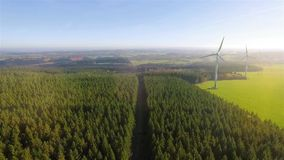 Birds eye view on Wind Power Turbine. AERIAL 4K / Ultra HD - Birds eye view on Wind Power, Turbine, Windmill, Energy Production - Clean and Renewable Energy stock footage
