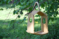 Birds feeder in the forest. Royalty Free Stock Photography