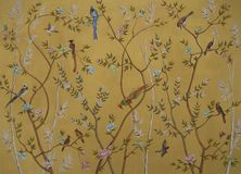 Birds and flowers on gold background stock illustration