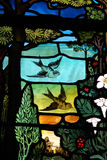 Birds and flowers in stained glass Stock Photo