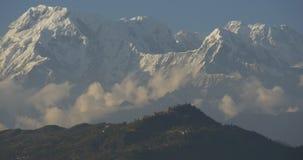 Birds fly near huge mountain stock footage