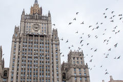 Birds fly over the building of the Russian Ministry of Foreign A Stock Photos