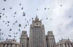 Birds fly over the building of the Russian Ministry of Foreign A Royalty Free Stock Photos