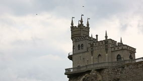 Birds fly over castle Swallow's Nest in Yalta stock video footage