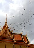 Birds flying over a palace Stock Image