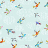 Birds flying. In the sky seamless pattern and illustration (vector Stock Images