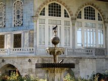 Birds in fountain in front of an arabic palace Stock Images