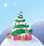 birds and gifts under the christmas tree Stock Images