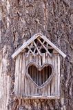 Birds house with heart-shaped entrance Stock Photo