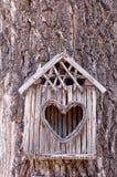 Birds house with heart-shaped entrance Stock Photo