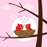 Birds in love. Red birds in love with heart Stock Photo