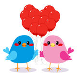 Birds Love Heart Balloons. Cute bird couple in love holding red balloons making a heart shape Stock Photo