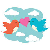 2 birds with love heart. 2 birds carrying a heart in the sky Royalty Free Stock Photos