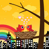 Birds in love in the morning with rainbow Stock Photo