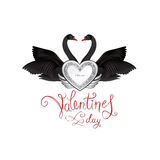 Birds in love with winged silver heart decoration and handwritte. N lettering St Valentine`s day. Couple of swans silhouette. Two love hearts concept Stock Photo