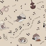 Birds, musical instruments, notes, song. Seamless texture with birds, musical instruments, notes, song  Warm coffee tone  Beige background  Use as background or Royalty Free Stock Image