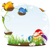 Birds in nests and Easter eggs Stock Photo