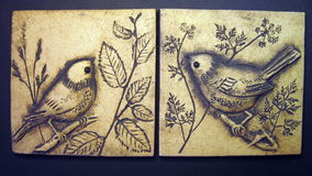Birds painted on clay Stock Images