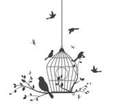 Birds silhouette with tree and birdcage Stock Photo
